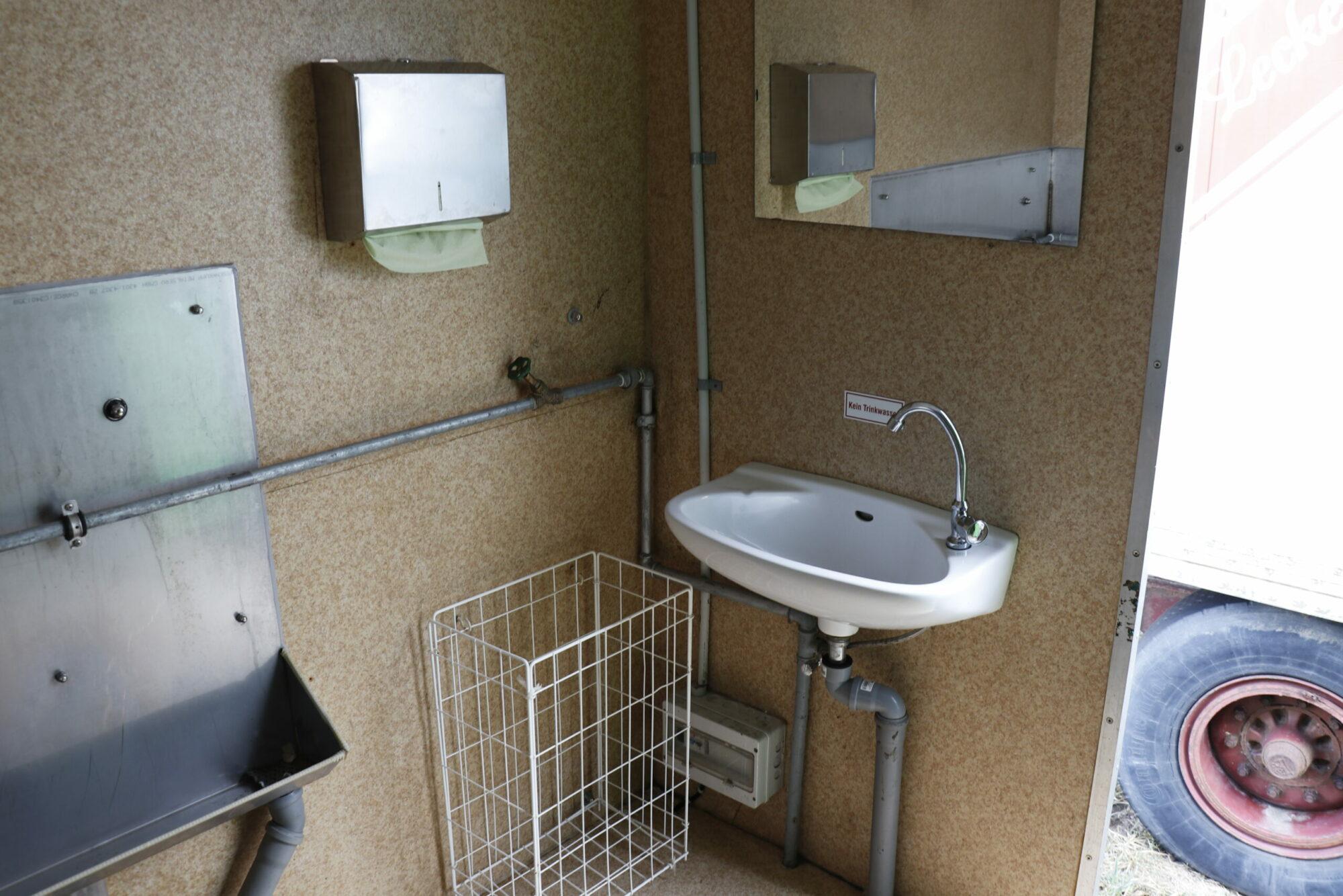 WC Herren Waschbecken